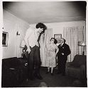This Is Eddie Carmel, A Jewish Giant, With His Parents In The Living Room Of Their Home In The Bronx, N.y. 1970