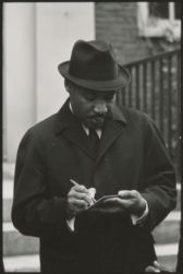 King, Martin Luther, guest preacher at Memorial Church [three-quarter view], January 1965
