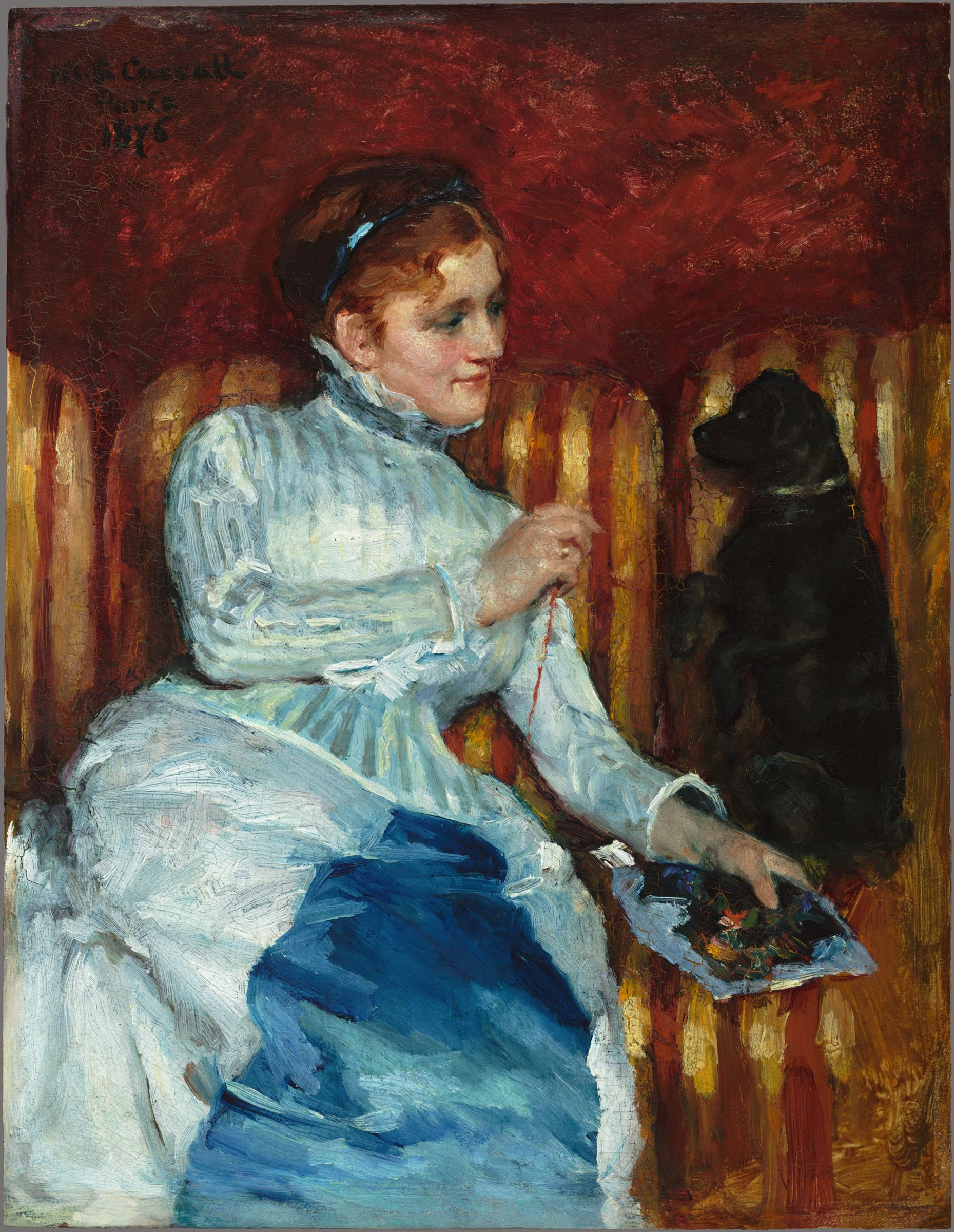 Woman On A Striped Sofa With A Dog