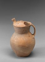 Globular Ewer With Angular Neck, Strap Handle, Short Spout, And Top In The Form Of A Laughing Human Face