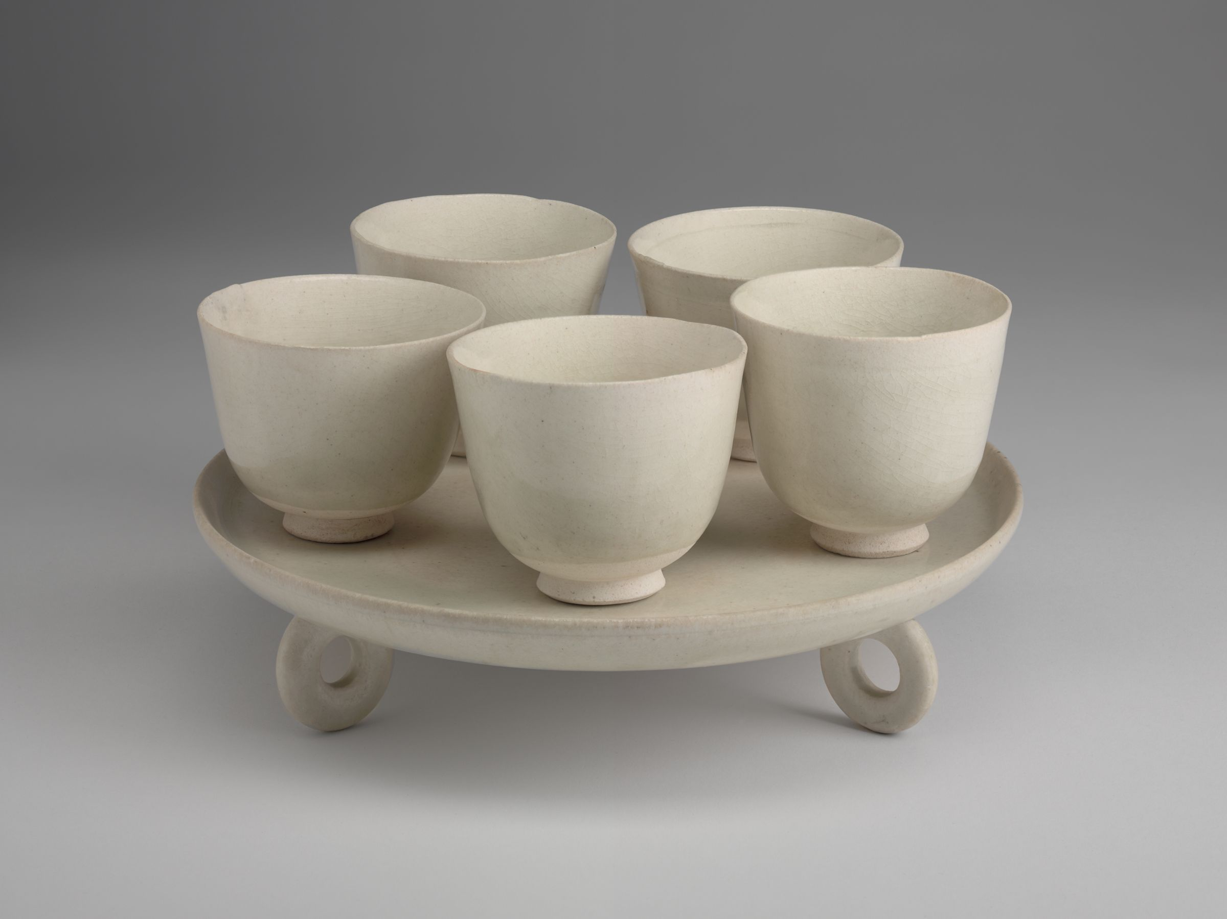 Circular Tray With Three Ring-Form-Feet And Five Cups
