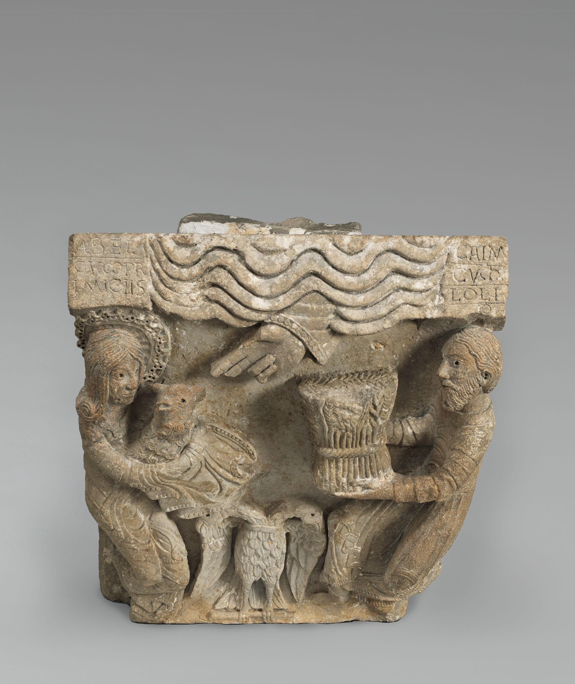 Capital From Moutiers-Saint-Jean; Principal Face: The Sacrifice Of Cain And Abel; Right Face: Samson Wrestling The Lion; Left Face: Tree Of Life(?)