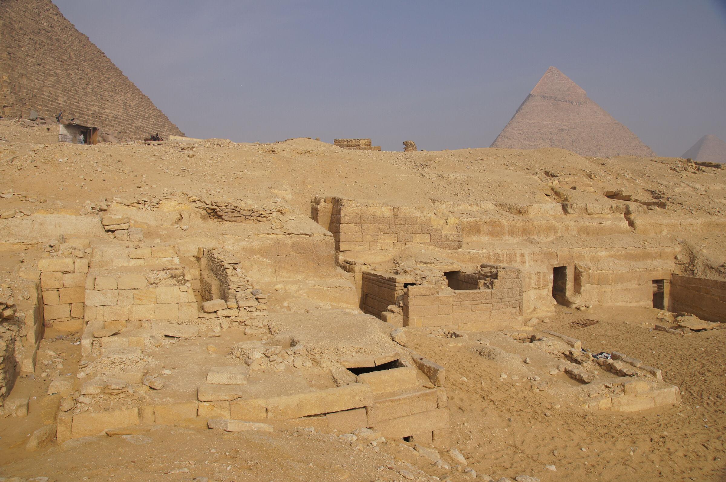 Menkaure Quarry Cemetery: Site: Giza; View: MQ 136, MQ 106, MQ 123, MQ 105, MQ 120, MQ 134, MQ 121, MQ 130, MQ 101(?), MQ 131, MQ 132, Menkaure Pyramid, Khafre Pyramid, Khufu Pyramid