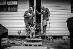 Peggy Gann, 61, her husband, George, 65, and their grandson, Mason, outside their home on August 23, 2017.