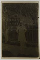 Untitled (girl posing outside, in front of fence, winter)