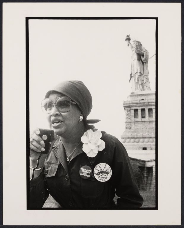 C. Delores Tucker, women reporter at Women's March at Liberty Island