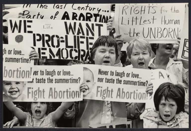 Anti-abortionists demonstrate outside the Waldorf Hotel where President Carter is staying