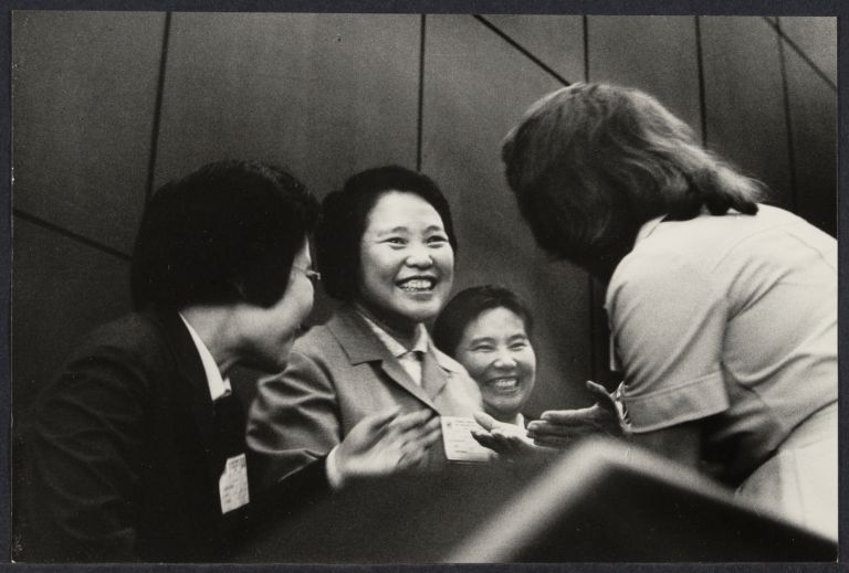 People's Republic of China delegates for the United Nations smiling and speaking.