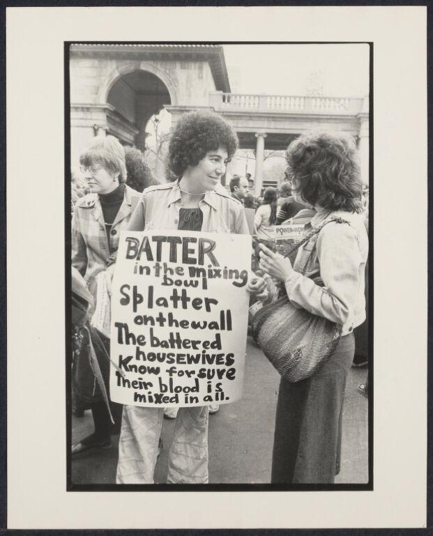 Battered women sign at International Women's day demonstration