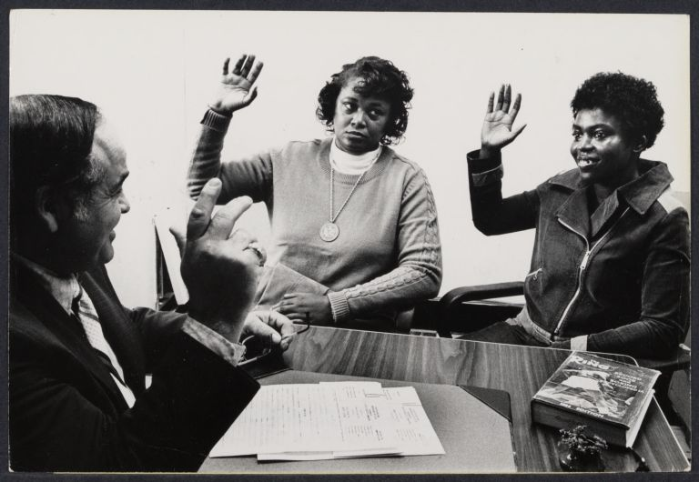 "The first two women ever to apply for boxing licenses, Jackie Tonawanda and Marian ""Lady Tyger"" Trimiar, being sworn in by NY State Boxing Commissioner"