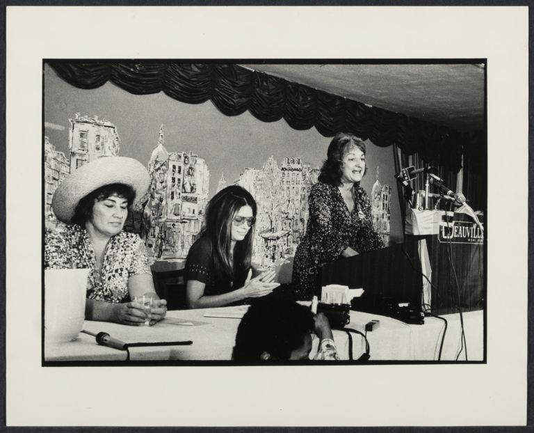 Bella Abzug, Gloria Steinem, and Betty Friedan (speaking) at the Women's Caucus at the Miami Democratic Convention