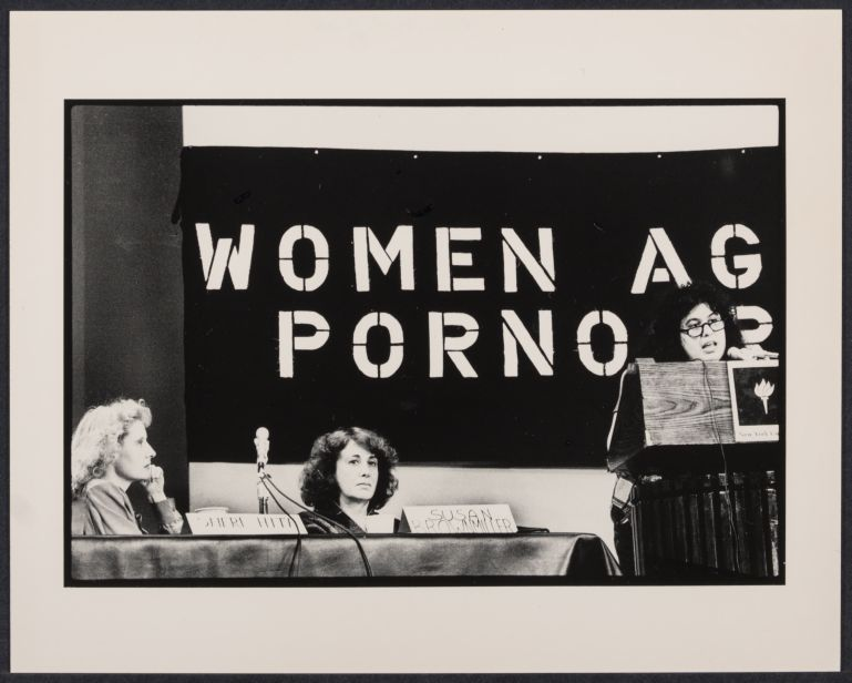Shere Hite, Susan Brownmiller, and Andrea Dworkin (speaking) at pornography speak out, December 2, 1981, by Bettye Lane