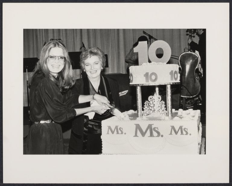 MS. magazine's 10th anniversary party with Gloria Steinem (left) cutting the cake with editor Pat Carbine
