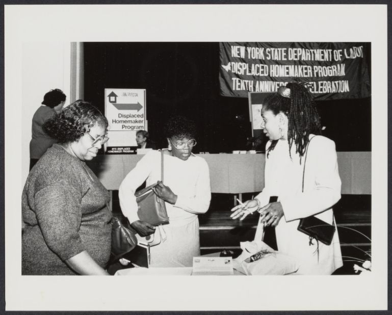 "Displaced homemakers conference with the banner ""New York State Department Displaced Homemaker Program Tenth Anniversary Celebration"""