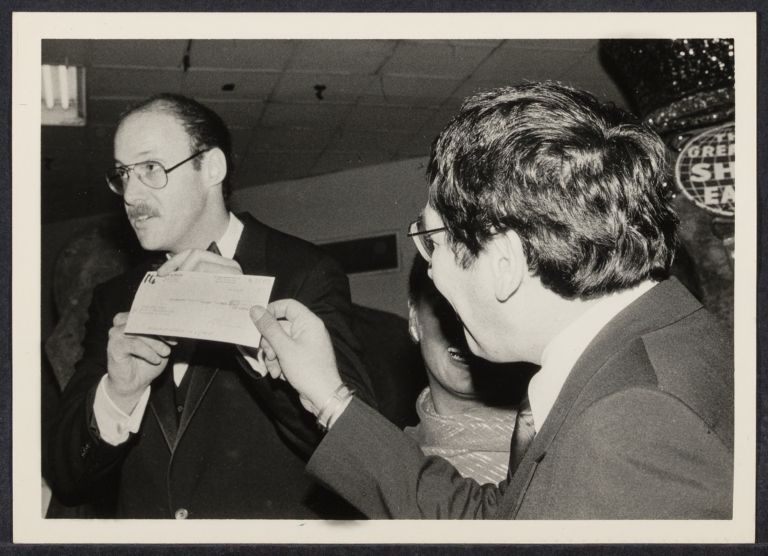 AIDS benefit press conference at Madison Square Garden, Ted Weiss, NY City Council presents a $500 check to Mel Rosen