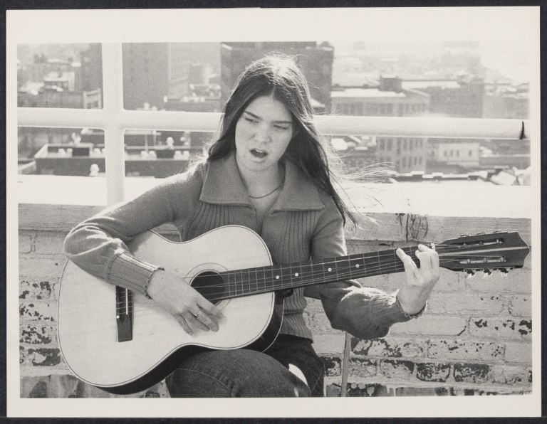 Sara, age 15, plays the guitar