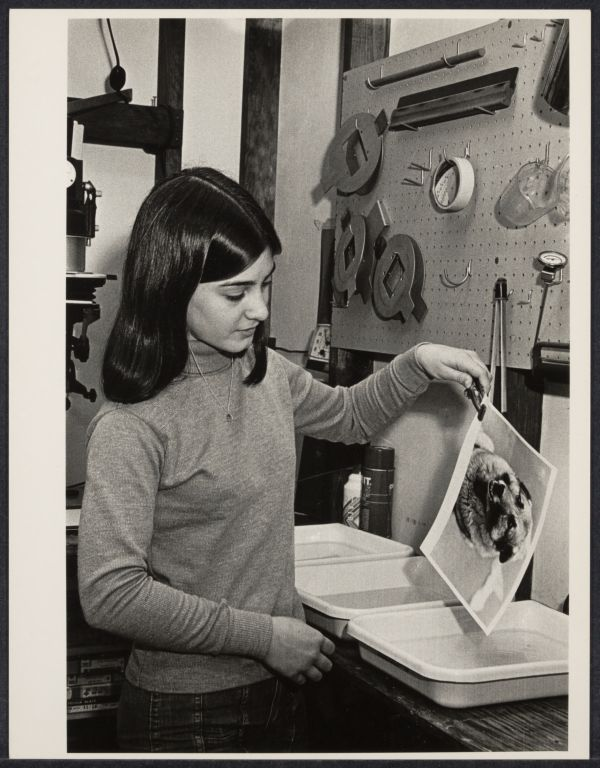 Teenage photographer working in darkroom