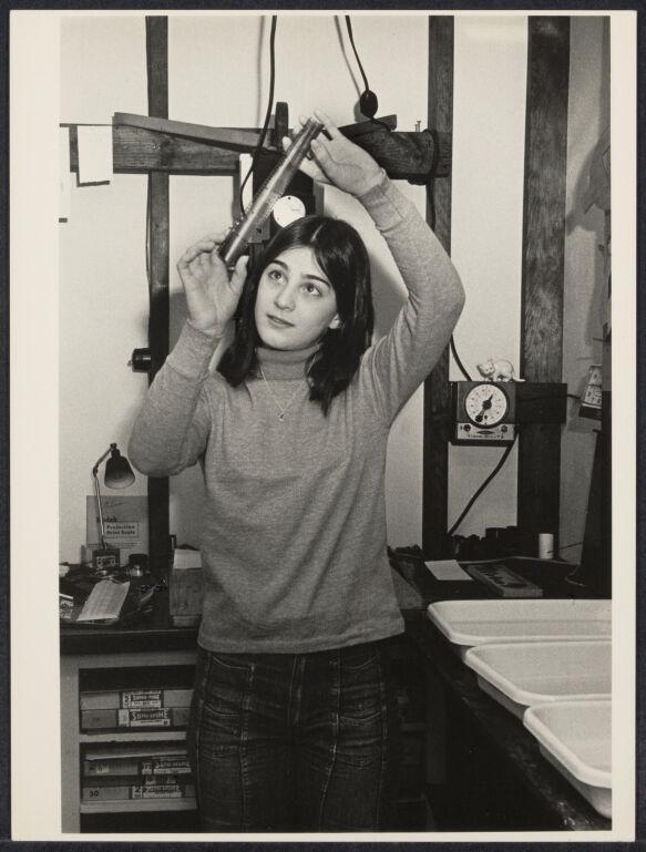 Teenager photographer working in darkroom