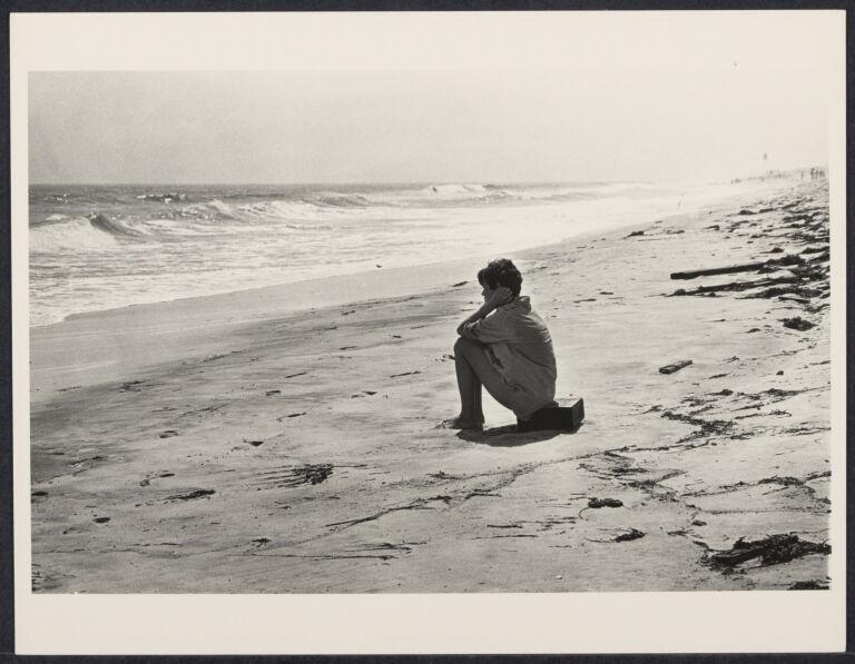 Teenage girl sitting on the beach
