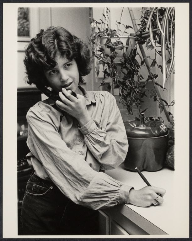 Teenage girl talking on the telephone