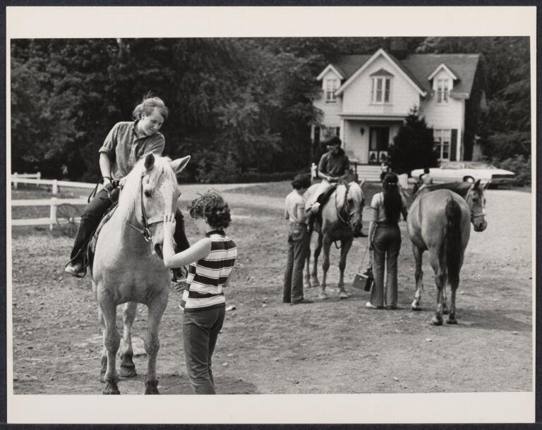 Teenage girl on horseback at Clove Lake Stables, Staten Island, New York