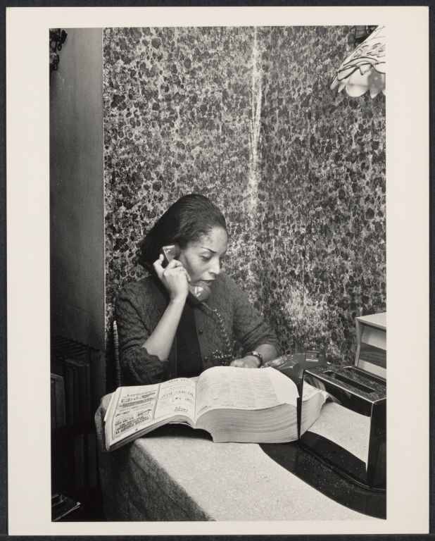 Woman makes a telephone call
