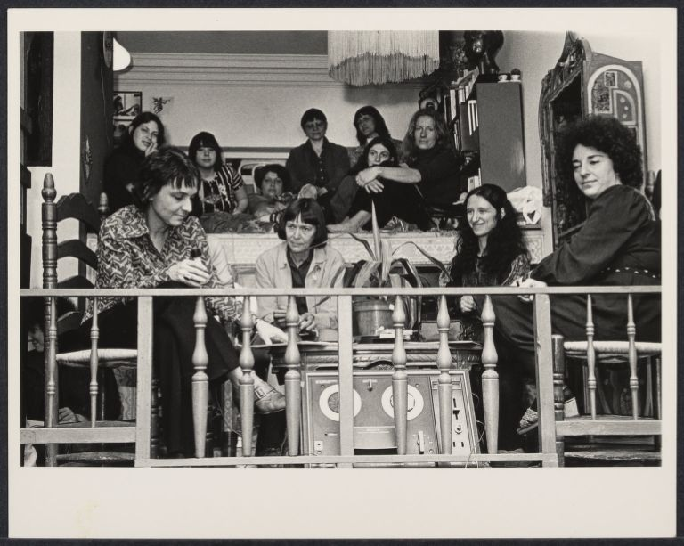 Left to right: Adrienne Rich, Barbara Demin, Erika Duncan, and Glora Orenstein at the Woman's Salon seated on a balcony.