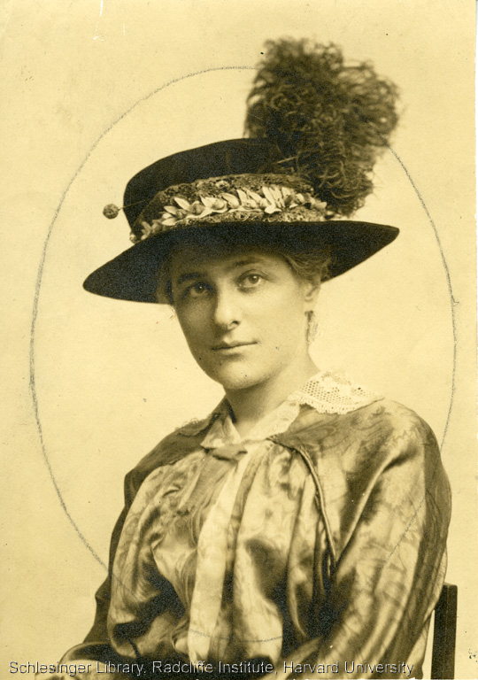 Formal portrait of Pauline Goldmark wearing a feathered hat.