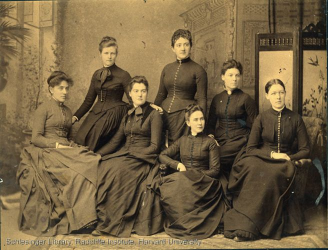 Formal portrait of seven women, including Claribel Merrill Hutchinson, medical interns at the New England Hospital for Women and Children.