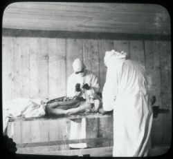 Drs. Strong and Teague performing autopsy
