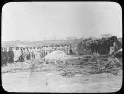 Stacks of unburned coffins and pile of ashes covered with lime, Changchun