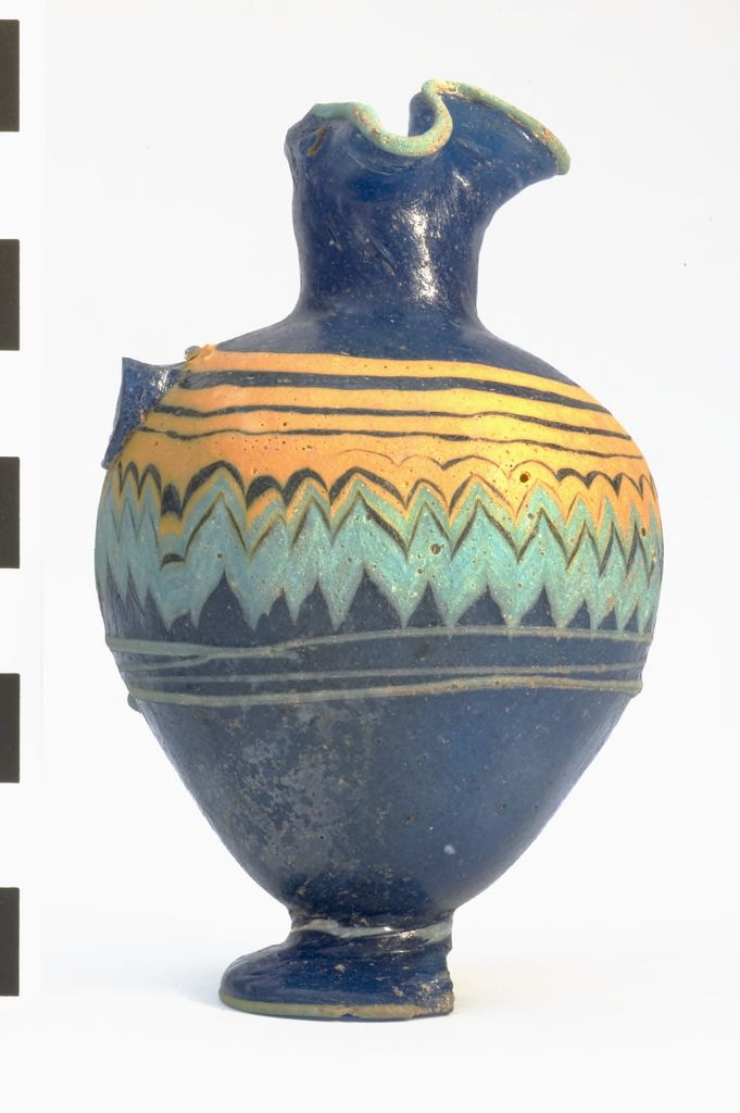 Core-formed glass oinochoe