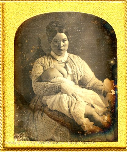 Unidentified woman breastfeeding a baby (presumably a mother and her child).