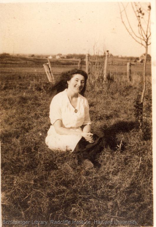 Ida Elizabeth Lavelli sitting in a field.