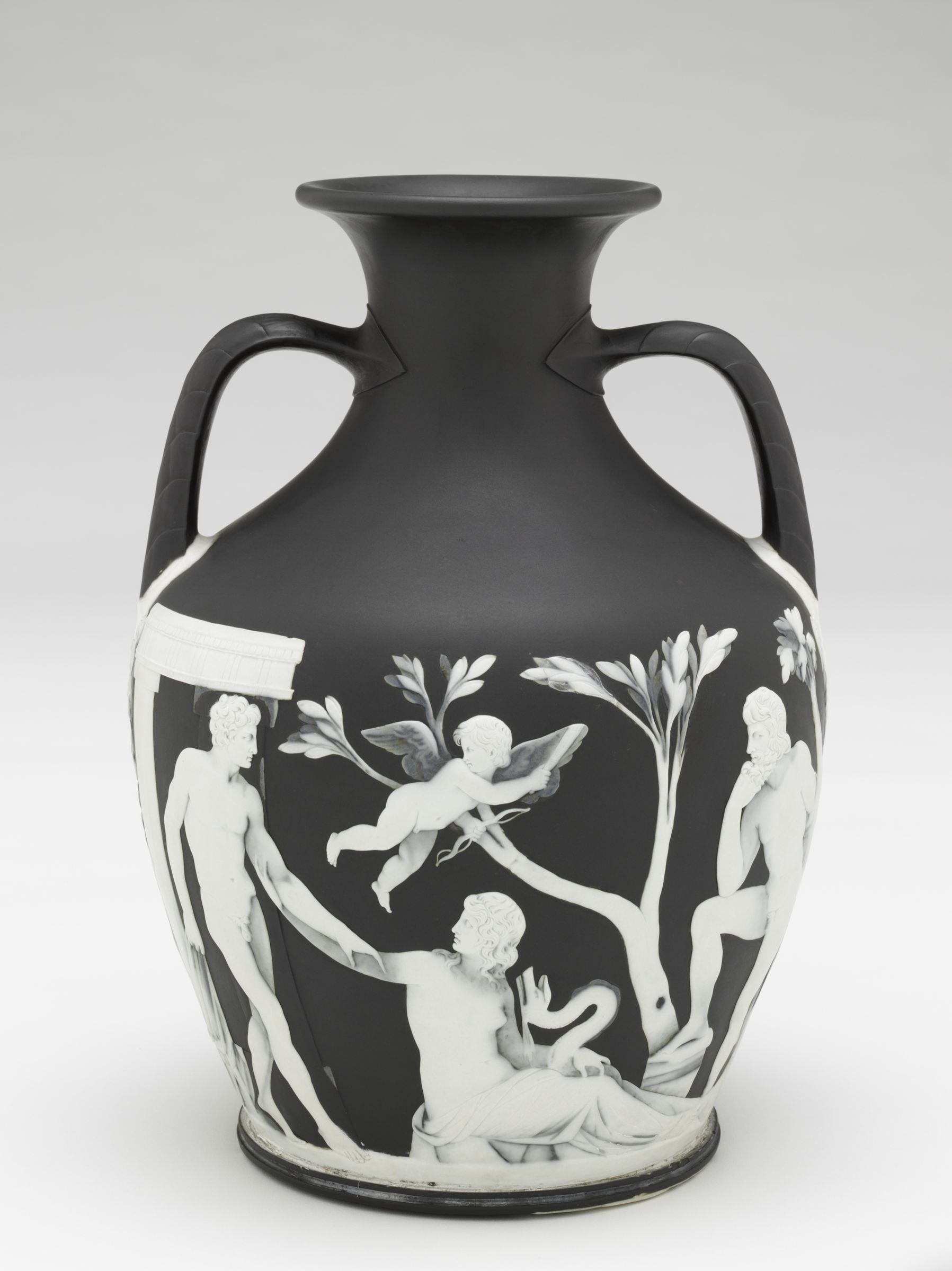 A vase with a wide body and tapered neck with two handles, decorated in shallow relief design, features two standing men, a cupid, and a sitting woman with a snake in front of a tree.