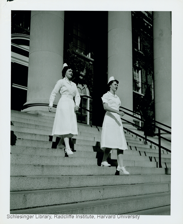 Portrait of two nurses exiting a building