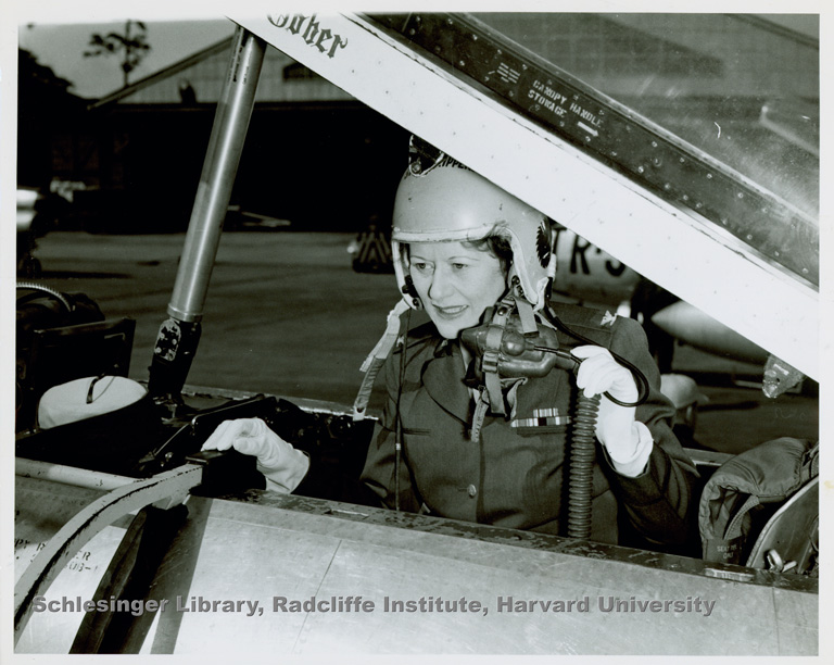 Portrait of Phyllis D.S. Gray (member of Women in the Air Force) in an airplane cockpit