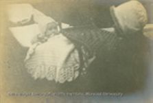 Baby album with twenty-four images of Mary Matteson Wilbur and Hollis Wilbur