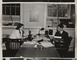 The News Office: Mrs. Roll and [Mrs.] Thompson and Mr. A. Ronald Ta'Bois, [photograph], Digital Object