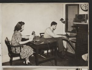 """Ronnie Phoenix, Radcliffe [class of 1944] announces while Robert Green [Harvard class of 1946] puts records on the turn table for the """"Swing Out"""" [photograph], Digital Object"""