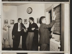 William L. Floot [Harvard class of 1944], Lawrence Creshkoff [Harvard class of 1946], and Richard L. Kaye [Harvard class of 1946] scheduling programs, [photograph], Digital Object