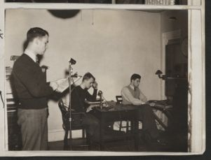 Lawrence Creshkoff and Michael Dawson [Harvard class of 1946] and Robert Green announcing news [photograph], Digital Object